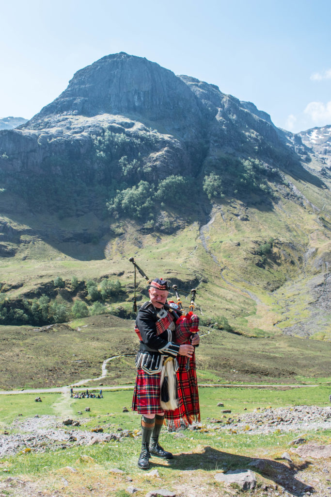 Scotsman playing bagpipes in Glencoe
