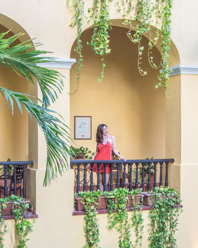 Girl overlooking balcony in Hotel El Convento