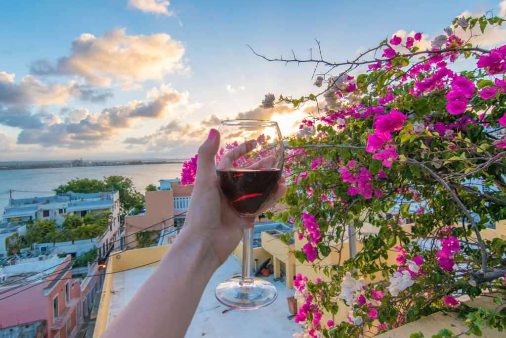A glass of wine over a beautiful sunset on the rooftop of Hotel El Convento