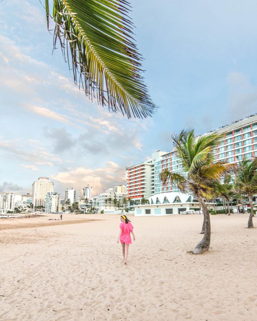 Girl walking in front of the shell at La Concha Resort San Juan, Puerto Rico