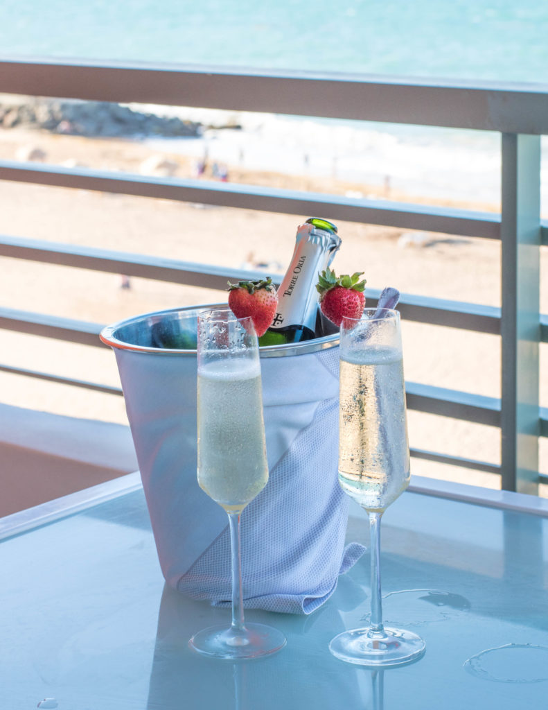 Champagne and strawberries with a view of Condado Beach, San Juan, Puerto Rico