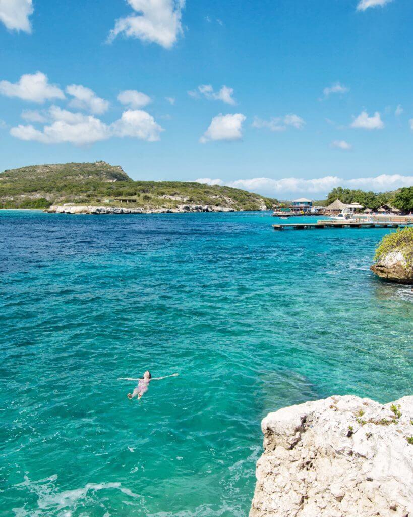 Woman floating in ocean in Willemstad, Curaçao
