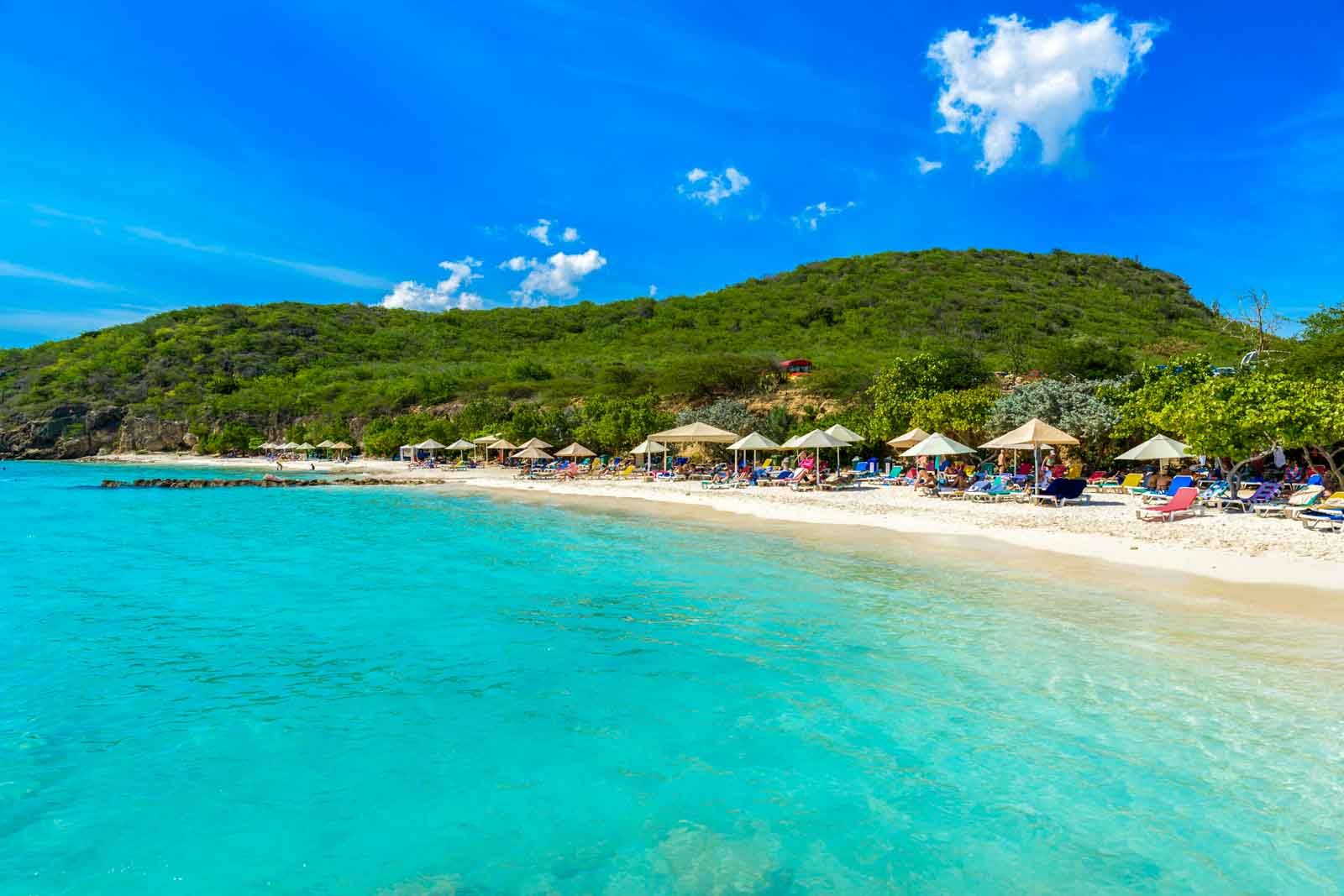 Photo of Playa PortoMari in Curaçao, showing beach with beach chairs and umbrellas and clear ocean water