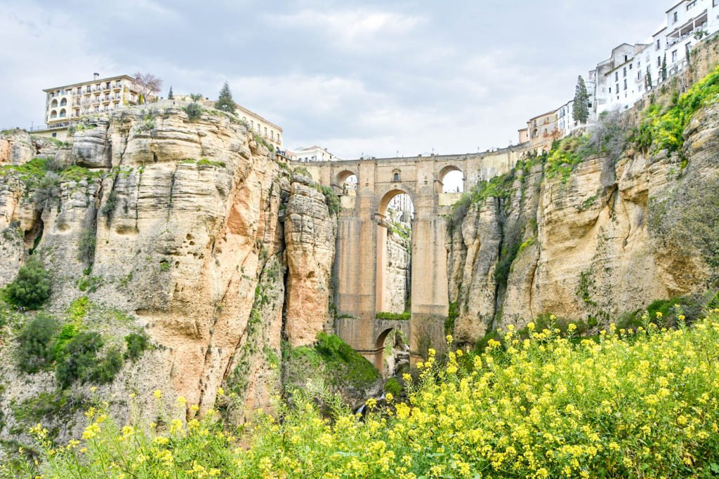 A view of the famous Puente Nuevo bridge, which divides Ronda and sits above the El Tajo Gorge.