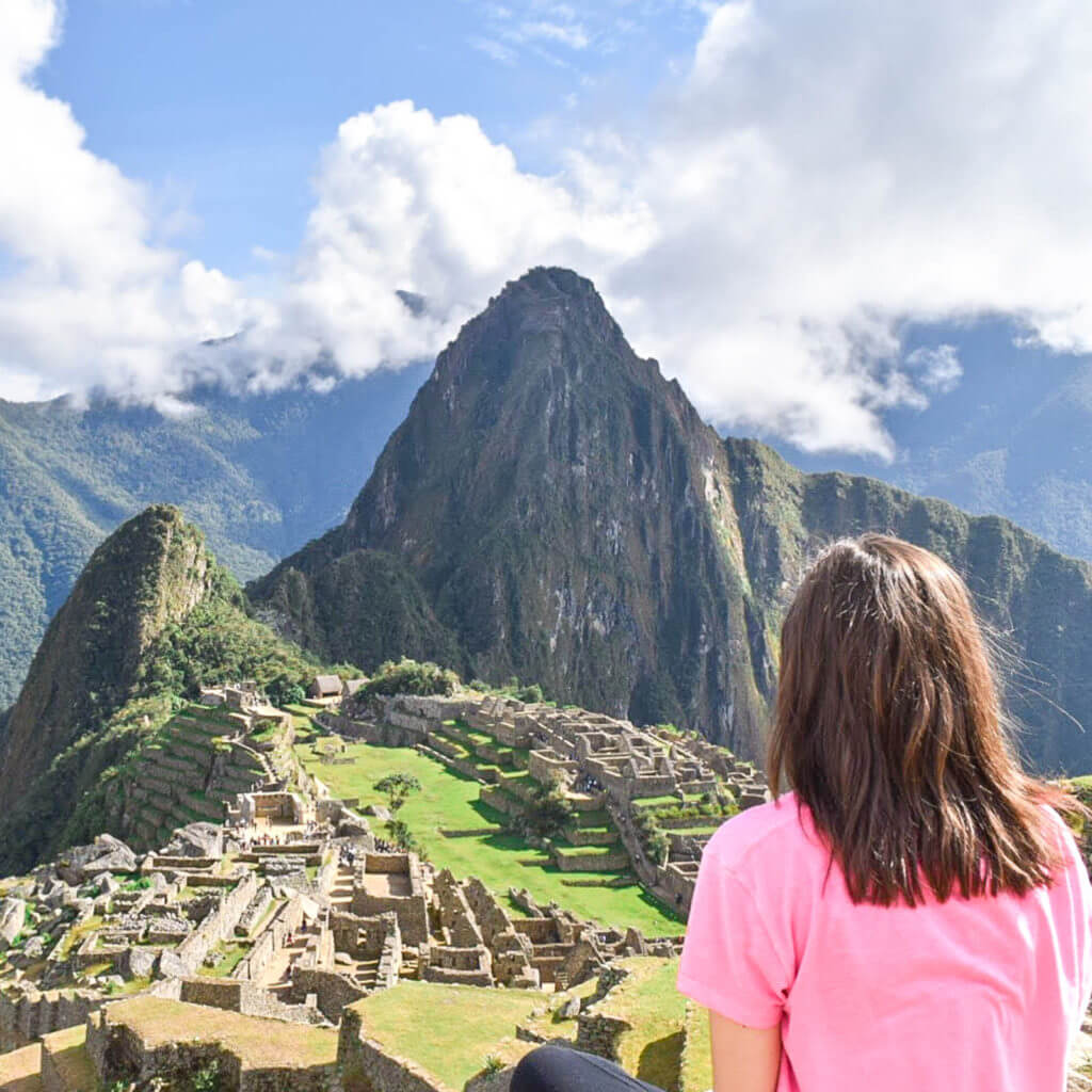 Woman looking out over Machu Picchu in Peru