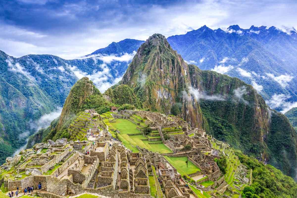 A view of Machu Picchu in Peru, with clouds surrounding it