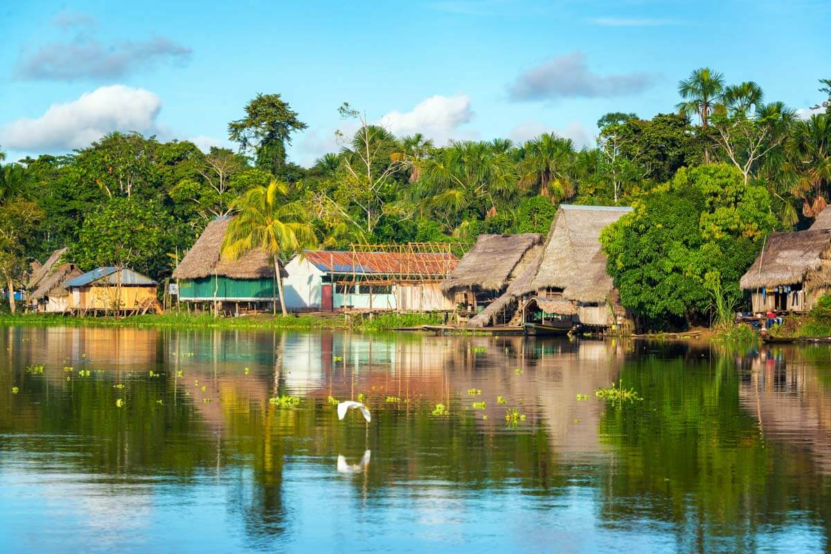 View of homes along the river in the Peruvian Amazon