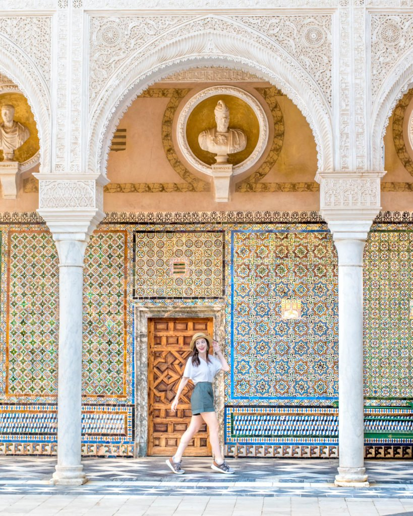 Girl walking under one of the arches in the Casa de Pilatos