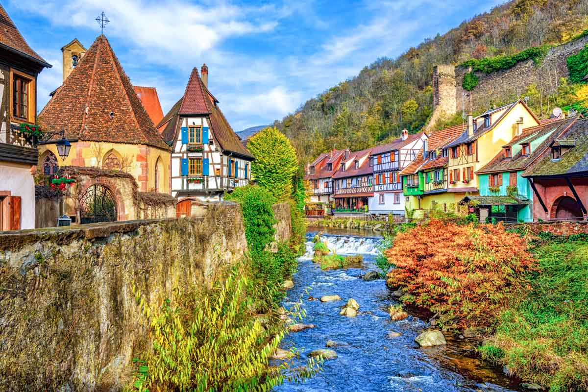 Colorful homes along a stream in Kaysersberg, Alsace, France