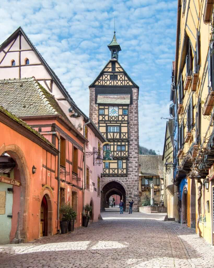 The Dolder Tower along a historic street in Riquewihr, Alsace Region, France