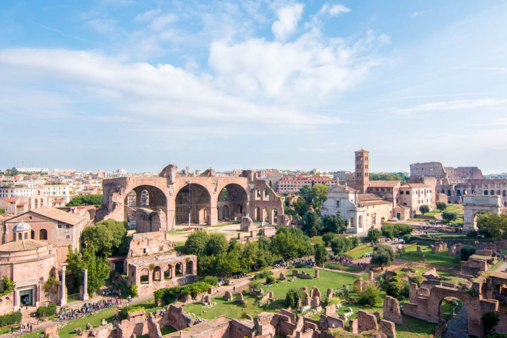 A view of Palatine Hill and the Roman Forum, with the Colosseum in the distance