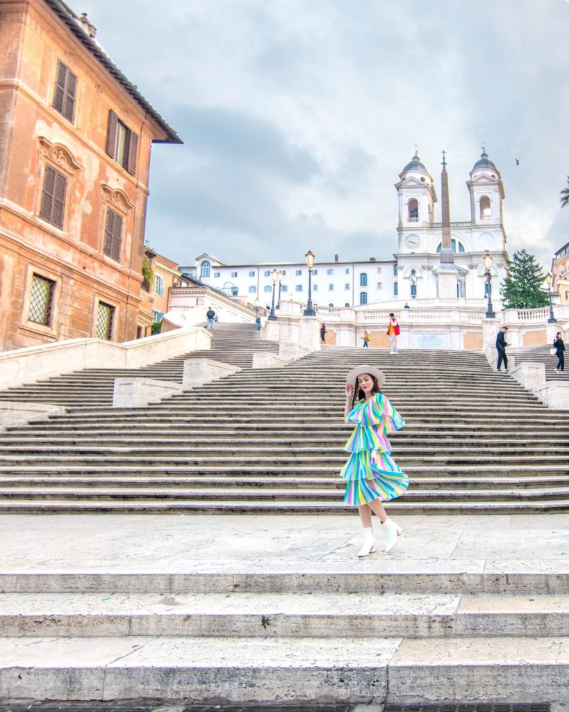 A girl spinning in a dress on the Spanish Steps in Rome