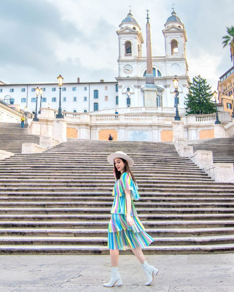 A girl walking in front of the Spanish Steps in Rome