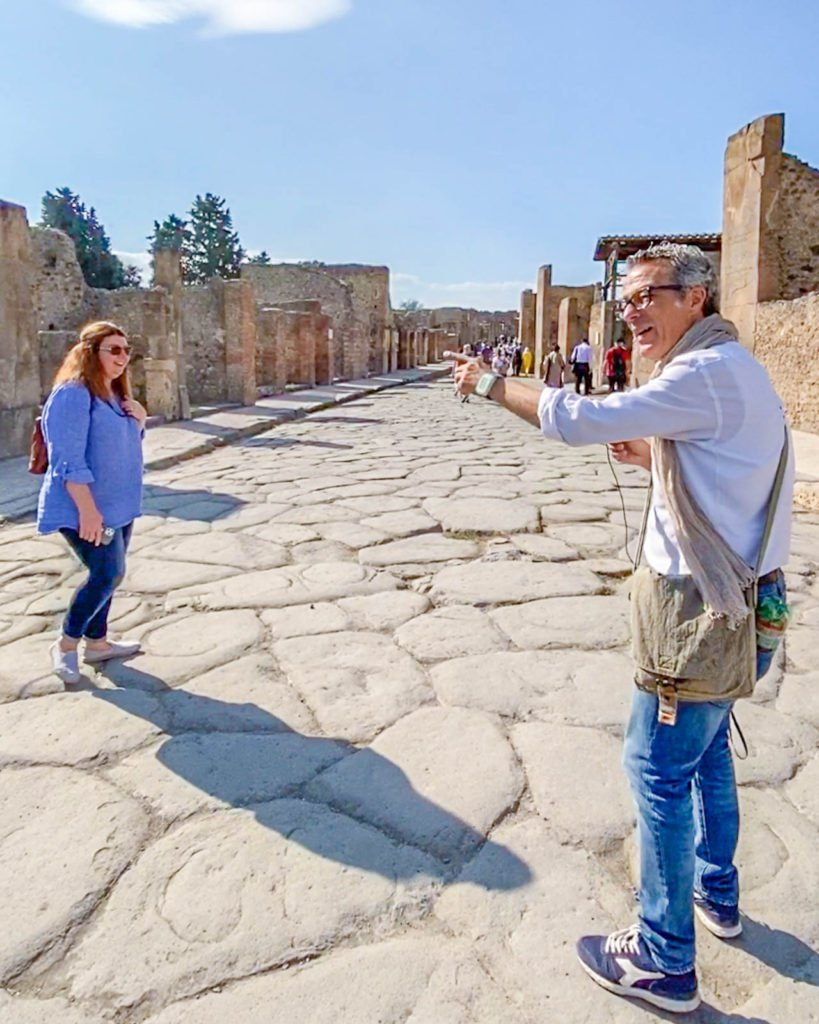 Guide walking the streets of Pompeii