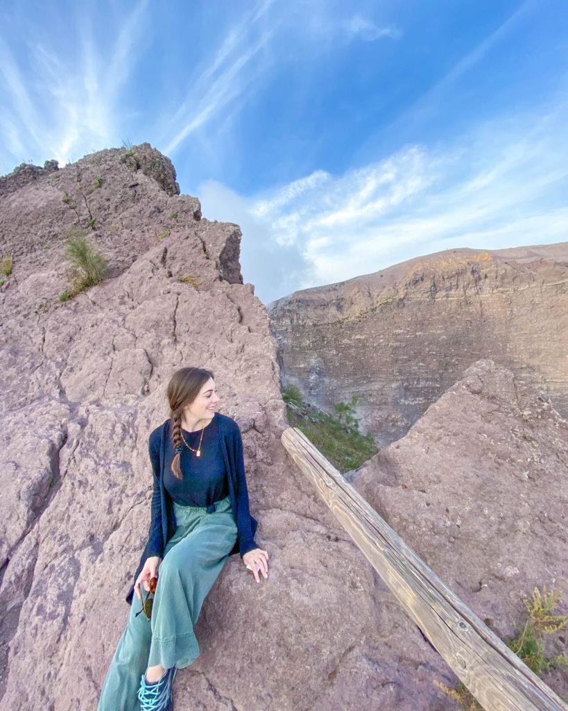 Girl sitting next to top of Mt. Vesuvius