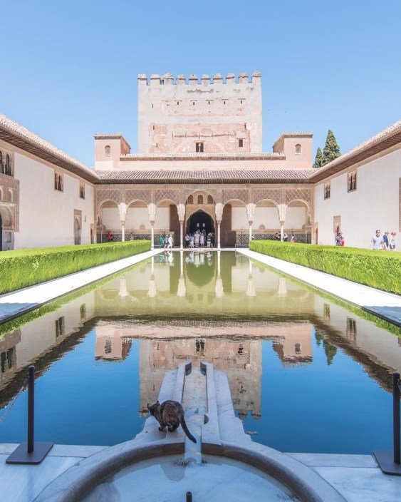 View of the Alhambra Palace with pool showing the building's reflection