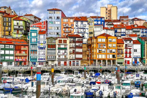 Colorful buildings in Bermeo in front of fishing boats