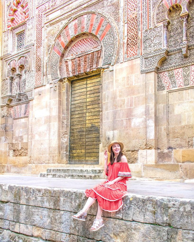 Girl sitting on the edge of the Mezquita in Córdoba, Spain.