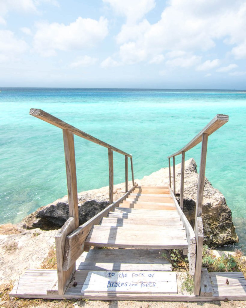 Staircase that leads down into turquoise ocean water in Aruba