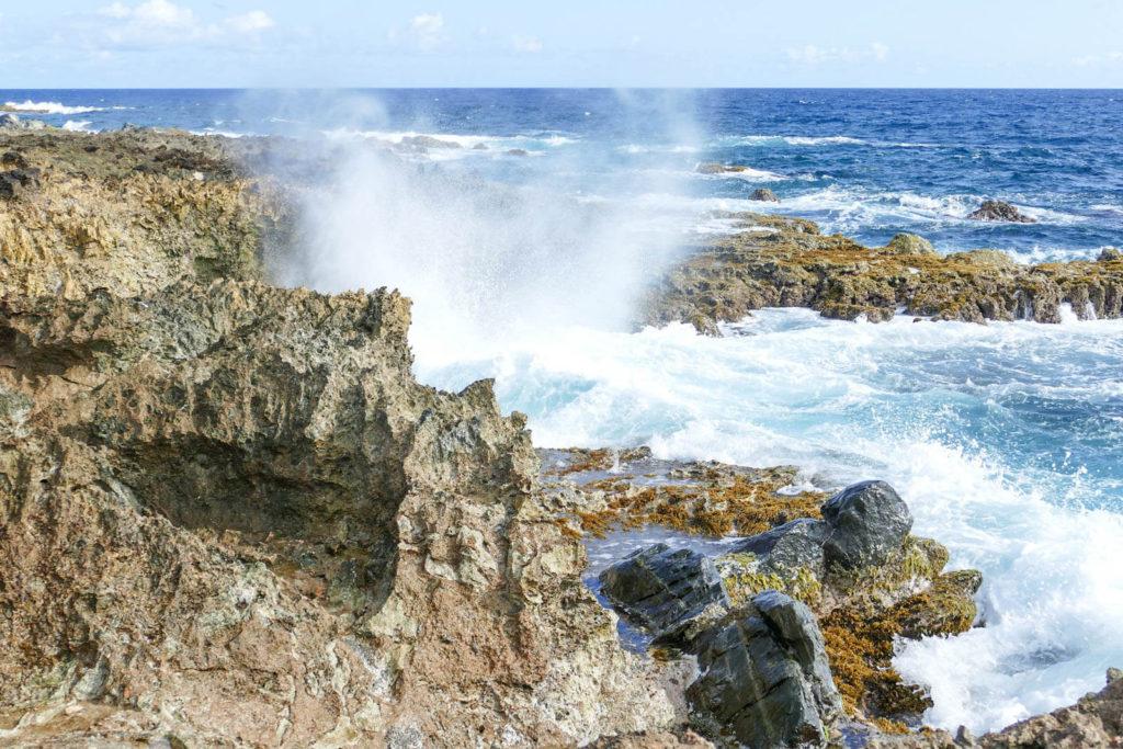 Waves crashing against rocks in Aruba