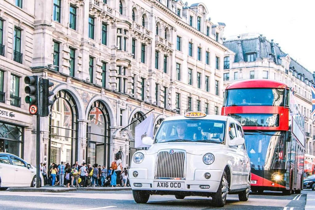 Oxford Street with a taxi and red double-decker bus in view