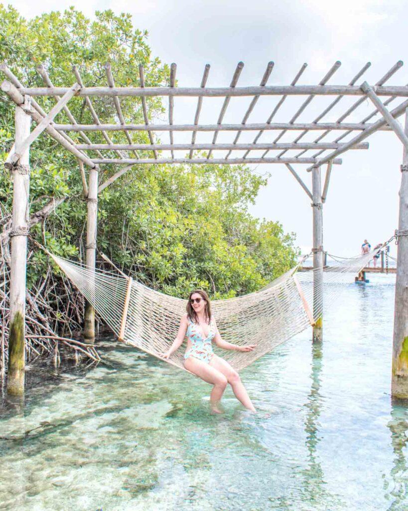 Woman lounging in hammock on Flamingo Beach Aruba