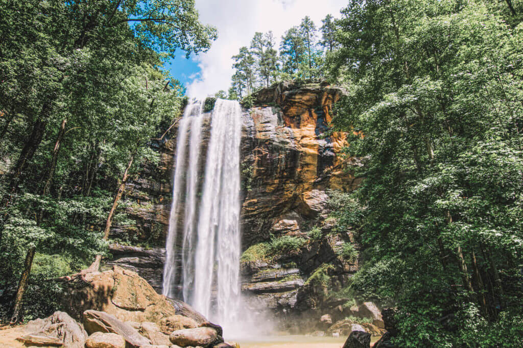 View of Toccoa Falls waterfall in Georgia surrounded by forest