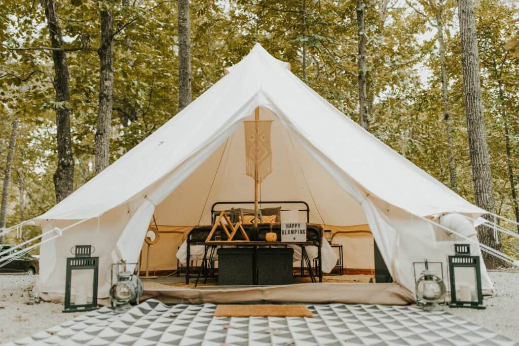 Large glamping tent from Georgia Glamping Co, showing bed and indoor set up