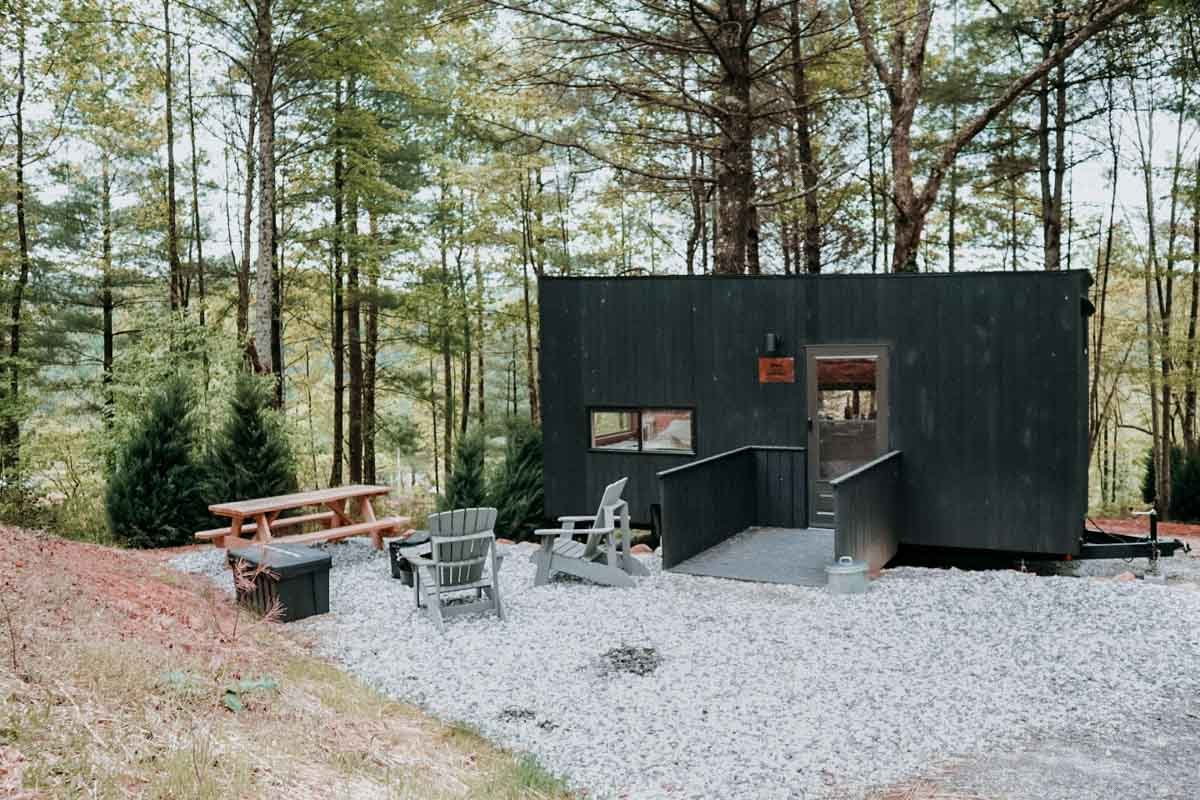 Photo of one of Getaway Chattahoochee's cabins, surrounded by forest.