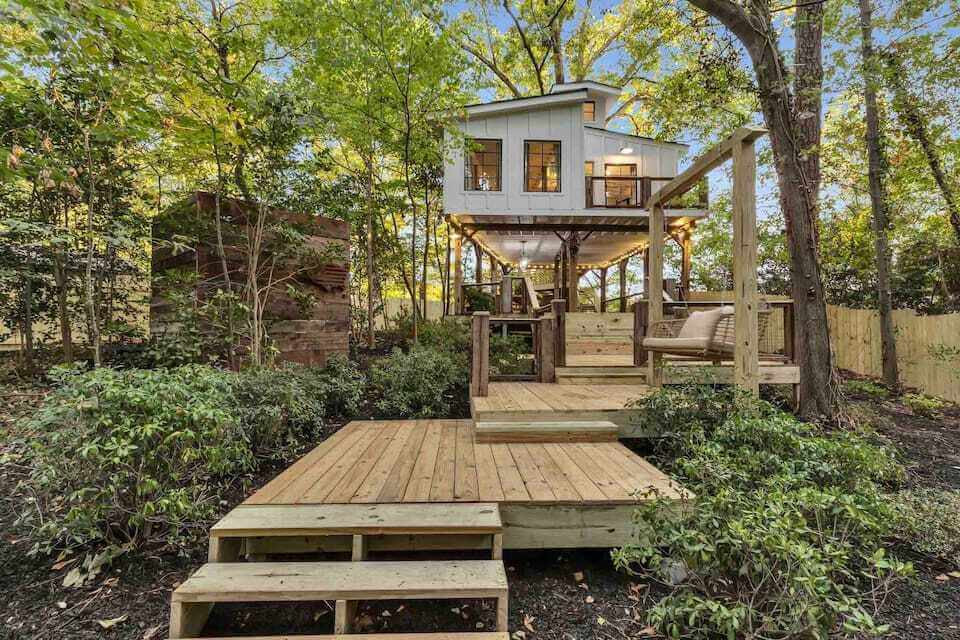 Front view of Atlanta Treehouse (romantic atlanta treehouse for couples), showing walkway and full treehouse surrounded by forest