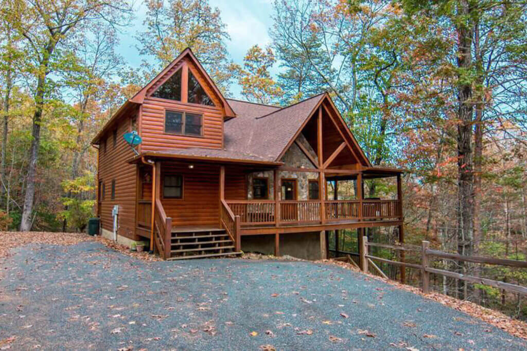 Front view of Blue Ridge Treehouse Cabin, surrounded by forest in North Georgia