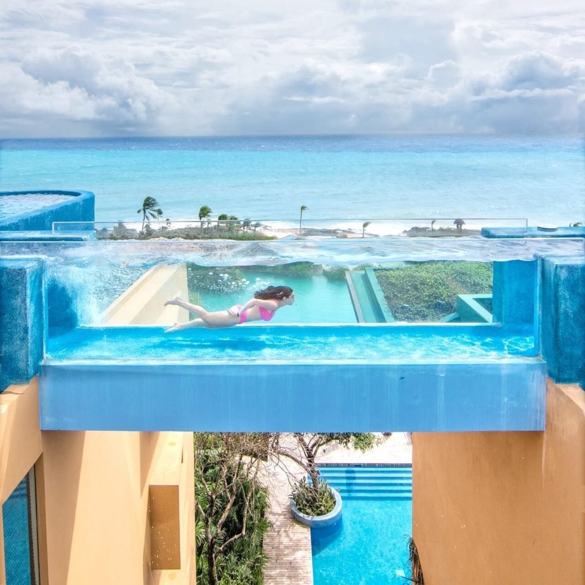 Girl swimming in hanging swim lane at Hotel Xcaret adults-only pool in Casa Fuego