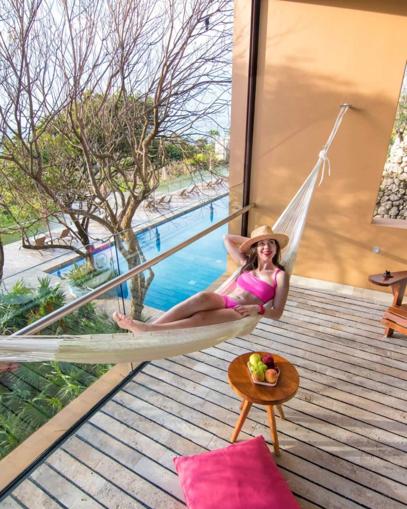 Girl hanging in hammock in suite at Hotel Xcaret Mexico