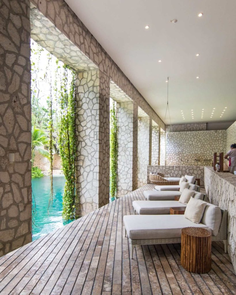 A view of Muluk Spa at Hotel Xcaret Mexico, with relaxing chairs and hanging vines