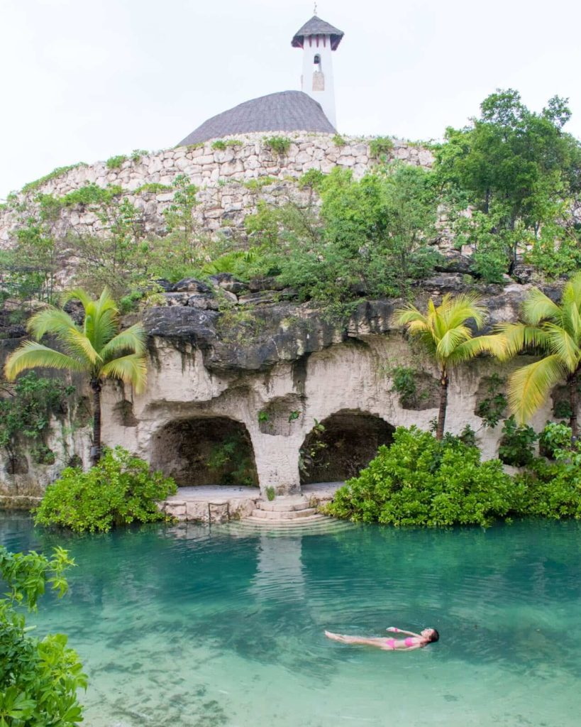 Girl floating in water at Hotel Xcaret Mexico