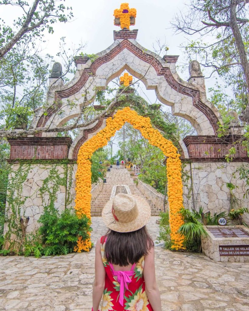 Girl in front of arch in the Mayan village at Xcaret Park