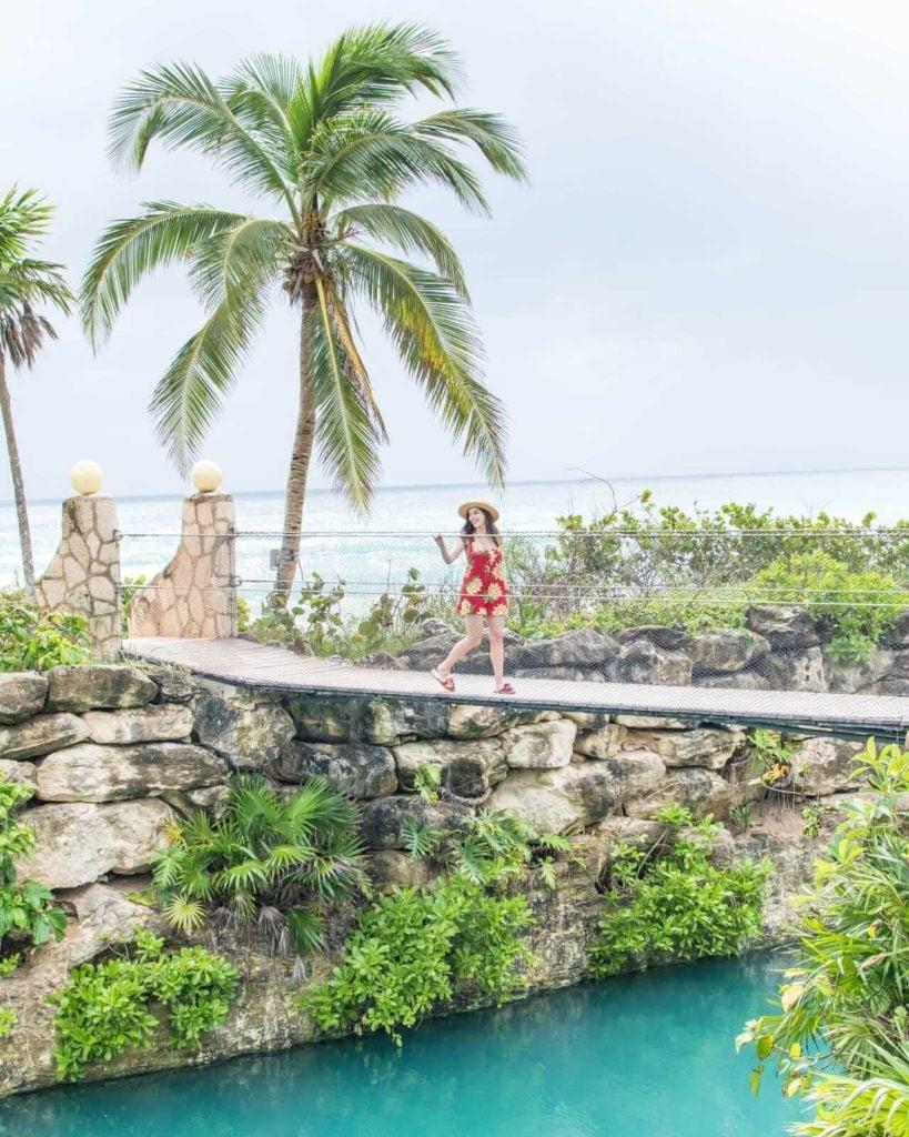 Girl walking over hanging bridge at Hotel Xcaret Mexico