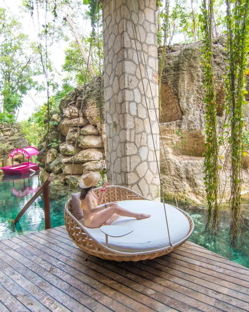 Girl on spa swing at Muluk Spa in Hotel Xcaret Mexico