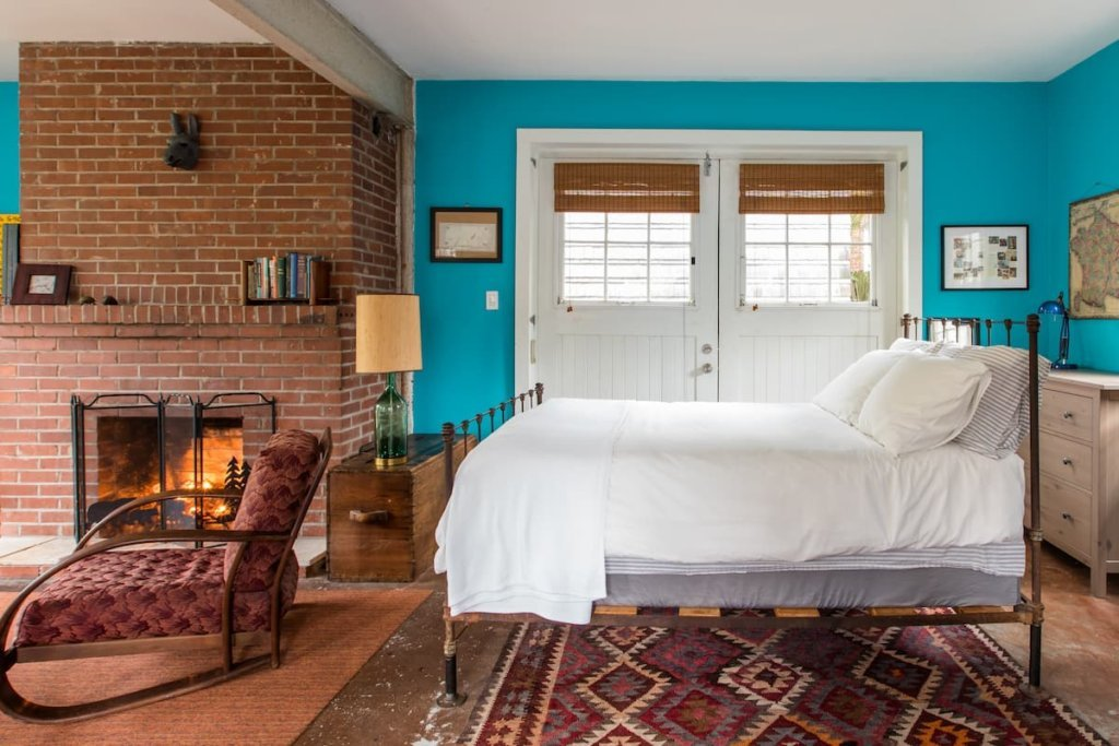 Photo of the bedroom area in the Cabin Apartment in 1914 Carriage House Revision listing on Airbnb