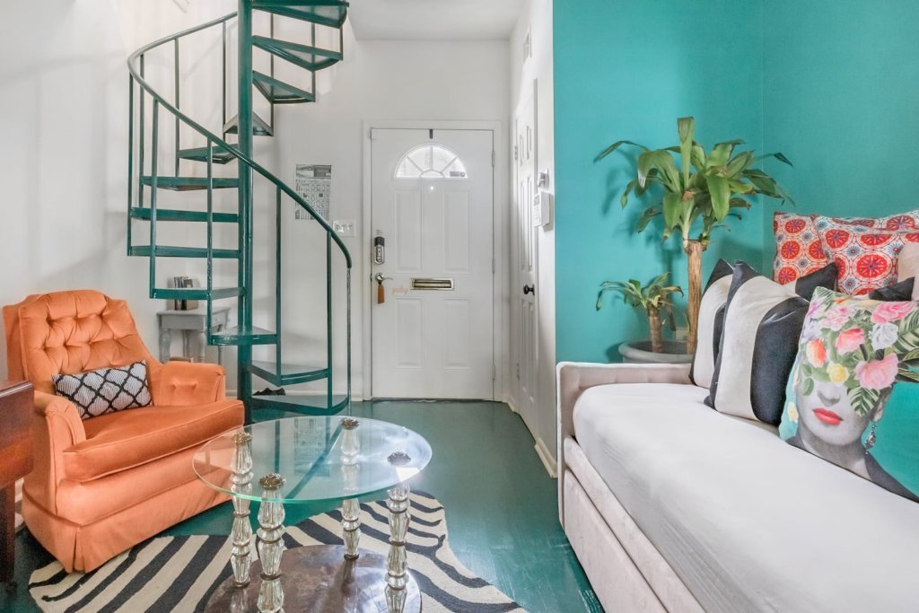 Photo of entryway, stairs, and sitting area in the Savor the Romance of a Colorful, Historic Carriage House listing on Airbnb