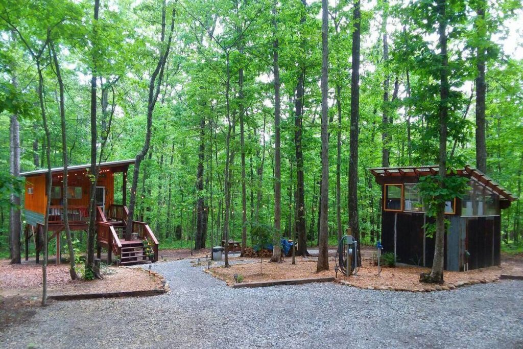 A view of the treehouse and the separate greenhouse bathhouse building