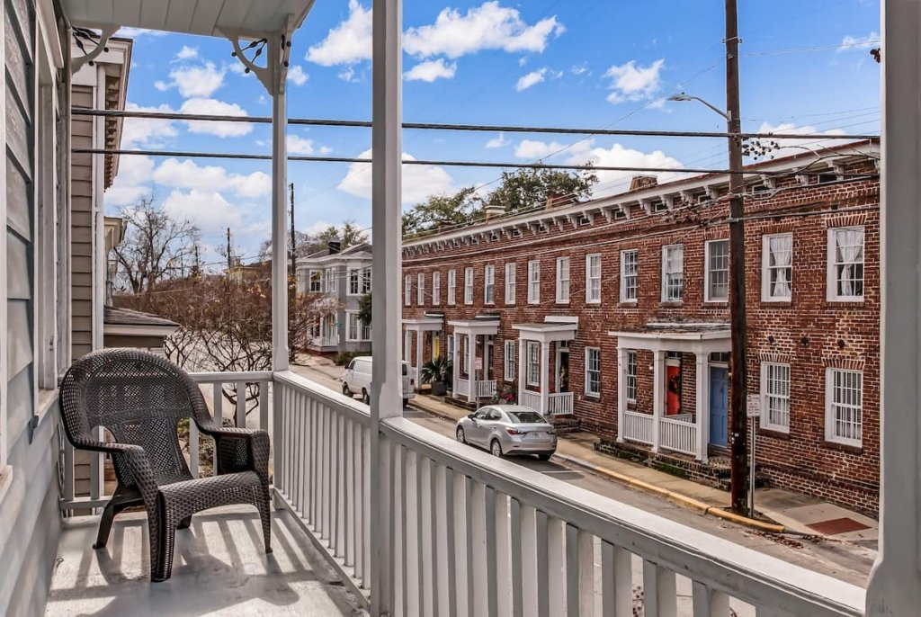 Photo of the porch with a view of the street in the Perfectly Renovated Historic Downtown Home listing on Airbnb