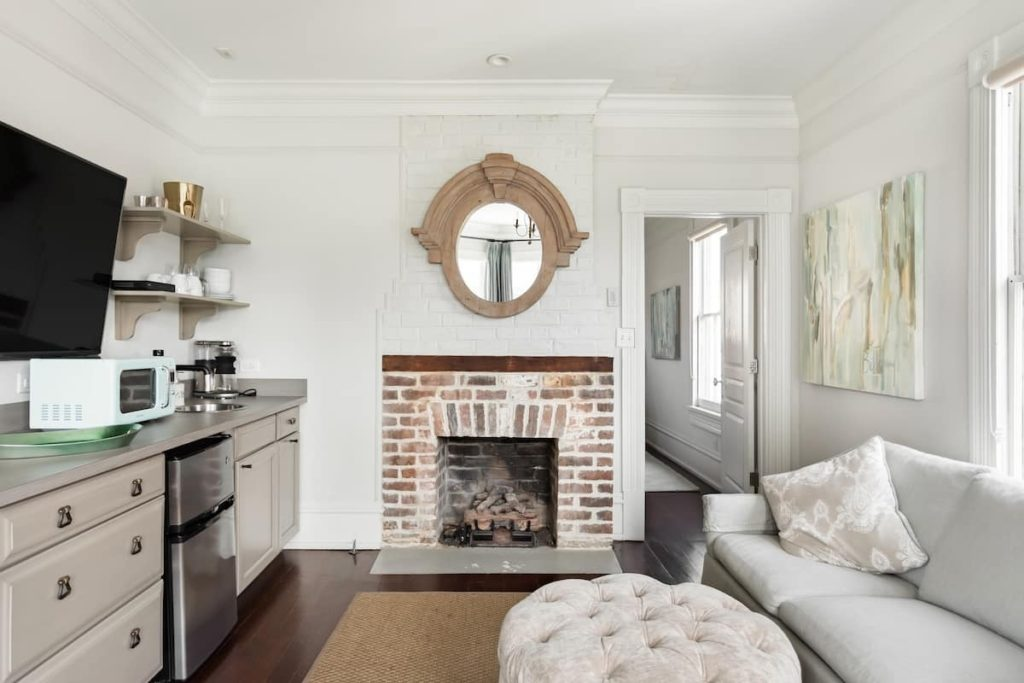 Photo of the sitting area with historic fireplace in the Rosemary Suite