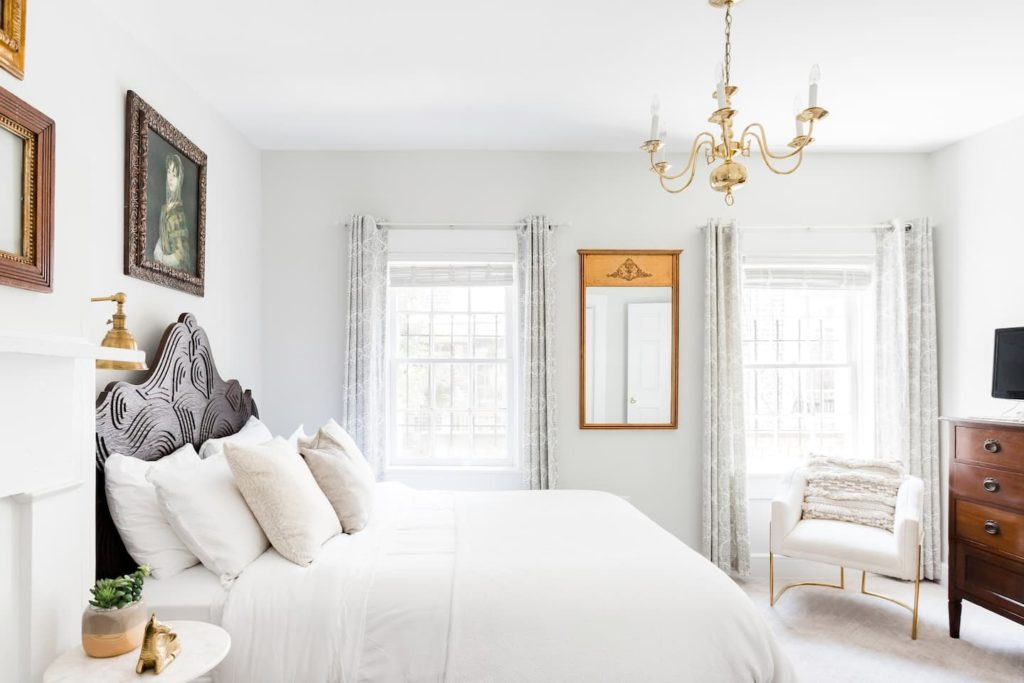 Photo of the bright and white bedroom in the Stylish Carriage House in the Historic District listing on Airbnb