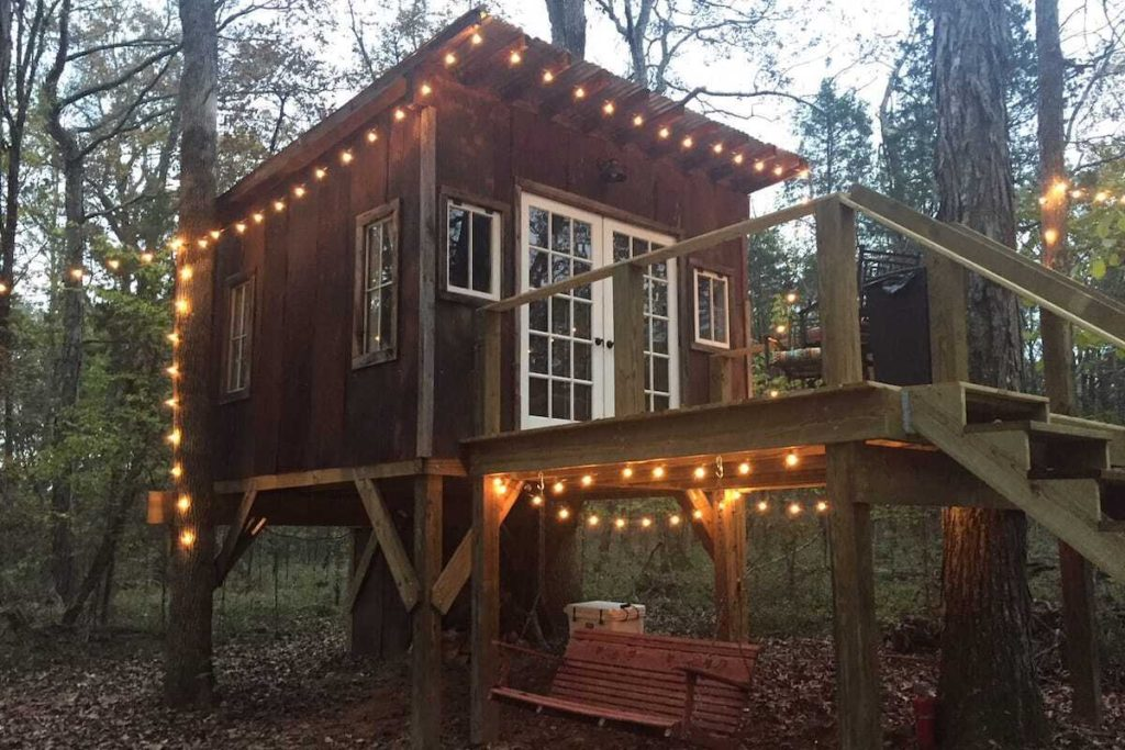 Photo of The Nest, Adult Treehouse near Nashville with lights along the walkway and roof