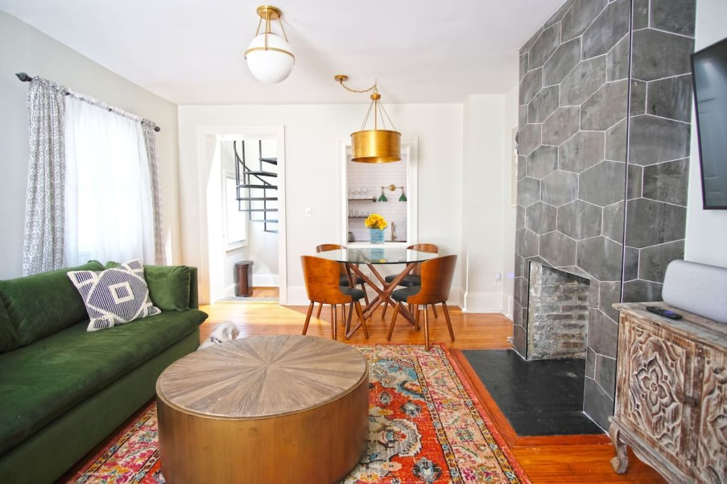 Photo of the living room area in the Vintage Carriage House on Chatham Square listing on Airbnb