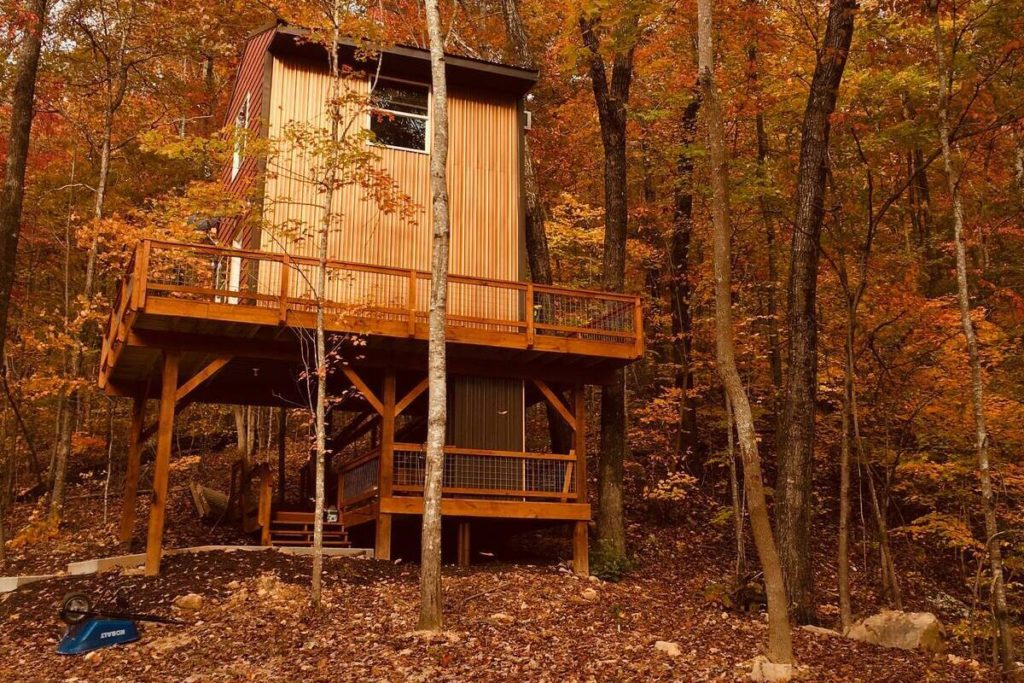 A view of Barn Owl Inn Treehouse in fall