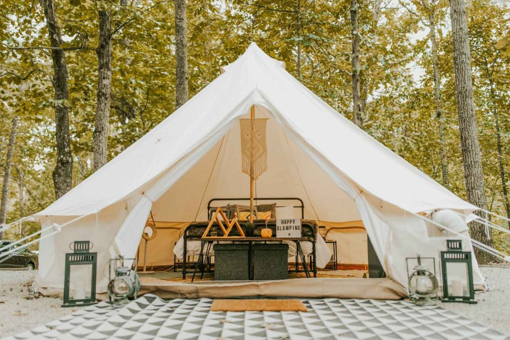 Photo of one Georgia Glamping company's tents, showing the inside and the comfy bed