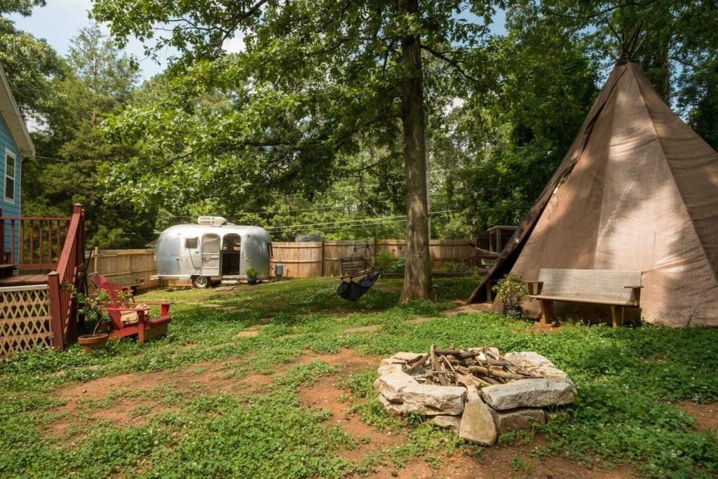 Photo of C.C. Homestead in Atlanta, Georgia, including a vintage camper and a glamping teepee