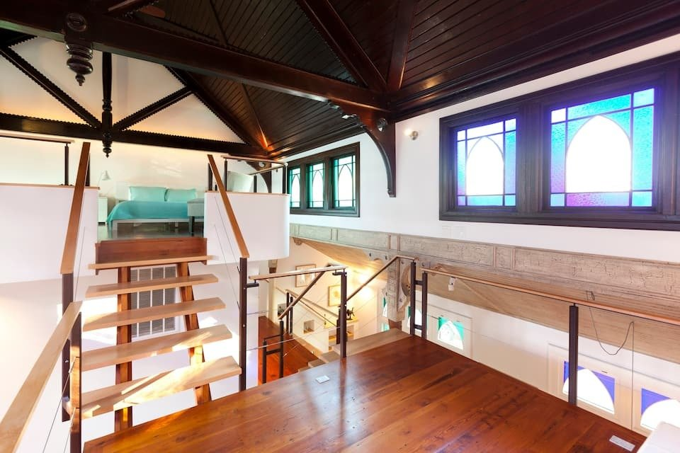Photo of open loft and bedroom area in Inner Sanctuary at Sanctuary Place listing on Airbnb